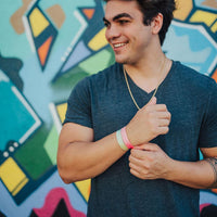 Lifestyle image of someone smiling with You Are Perfect For Something on their wrist and one other Zox wristband