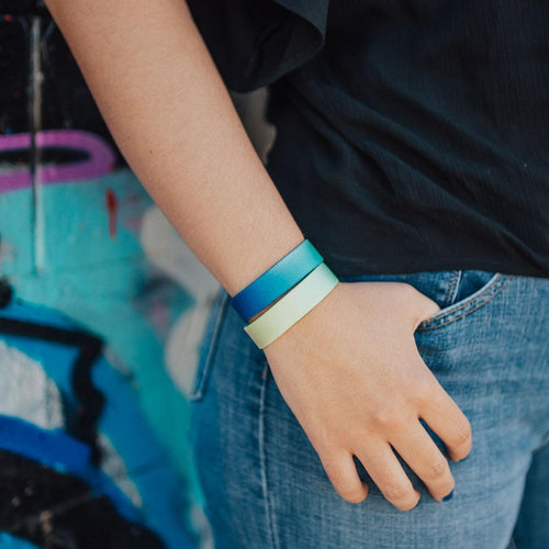 Lifestyle image of someone's hand in pocket wearing You Are Perfect For Something and another Zox wristband