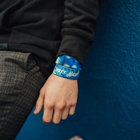 Lifestyle close up image of model's wrist wearing 2 Starry Night straps