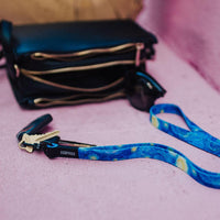 Lifestyle image of Starry Night Lanyard clipped to keys next to someone's purse