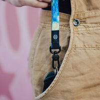 Lifestyle image of Starry Night lanyard being pulled from a pocket and clipped to keys