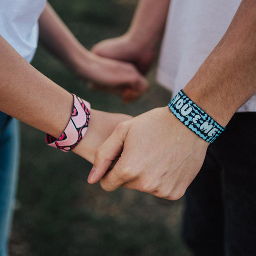 Models holding hands wearing one blue and one pink You & Me