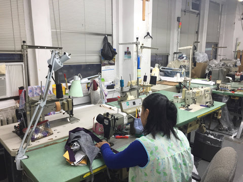 FineLine Studio NYC Employee sewing the Demi
