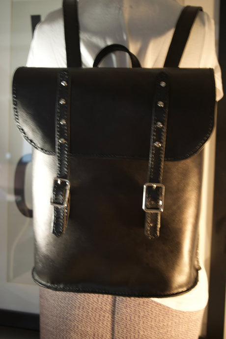 Double Stitched black leather backpack with silver hardware