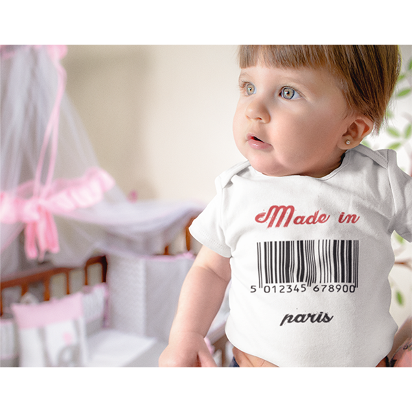 White t-shirt displaying a design with a barcode saying Made in Paris below it, this is a personalised design which can be customised with a country or town of your choice.