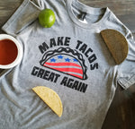 Make Tacos Great Again! printed in USA stars and stripes red, white and blue with a taco across the chest of a unisex soft style short sleeve heather grey t-shirt - featured with taco, lime and salsa - Dalton Ink