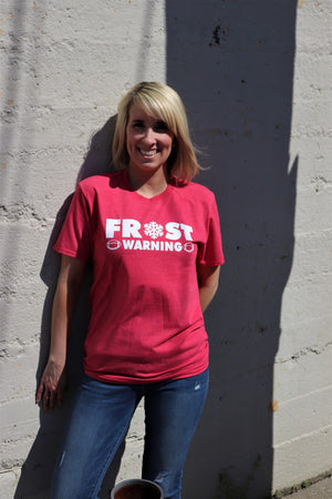 "Women wearing University of Nebraska Coach Frost Fun Novelty unisex heather red short sleeve soft style t-shirt with ""Frost Warning"" in white text across the front - Dalton Ink"