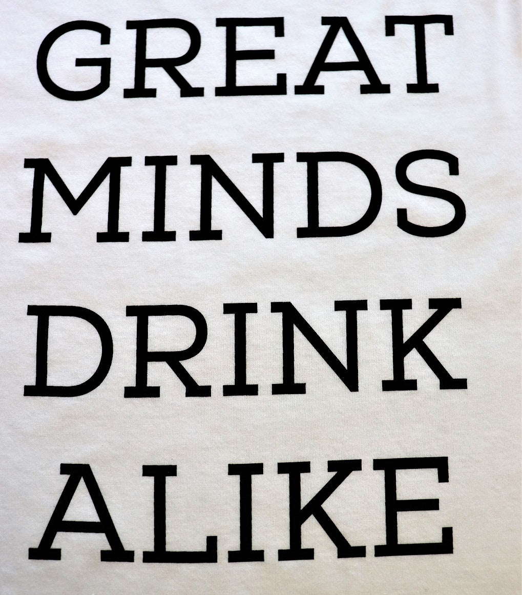 "Close Up of ""Great Minds Drink Alike"" in black text on a unisex baseball crew t-shirt white body and 3/4 black sleeves - Dalton Ink"