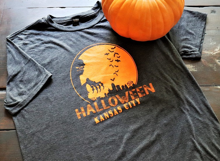 KC Halloween Skyline with Western Auto sign printed in Orange Ink on a soft style unisex short sleeve charcoal t-shirt - Dalton Ink