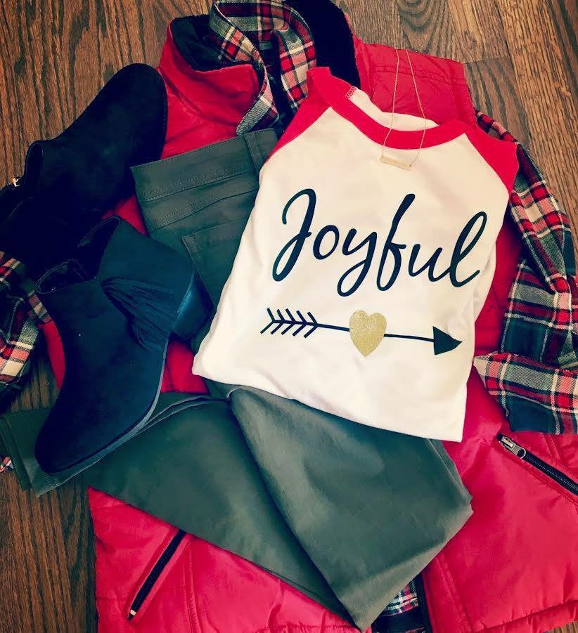 Display your love of the season for everyone to see with this red sleeved baseball tee with gold glitter heart with an arrow and Joyful across the front.  It really is the most wonderful time of the year. - Holiday and Christmas Clothing from Dalton Ink
