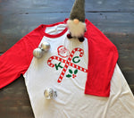 famed hipster crossed X design modified with two candy canes, KC to represent the Kansas City holiday spirit and featuring our own wonderful throwback Santa reminiscent of the 1950s.  Christmas and holiday clothing from Dalton Ink