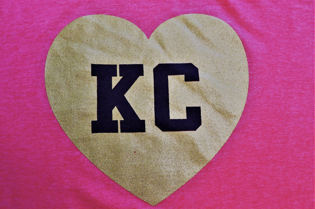 KC Heart - Glitter Gold Heart with KC in black lettering on a heather red unisex soft style unisex t-shirt close up  - Dalton Ink