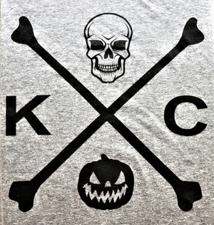 Close Up Kansas City Halloween Skull and Bones design in black ink featuring KC, jack-o-lantern and skull on a 3/4 sleeve baseball jersey soft style t-shirt - Dalton Ink