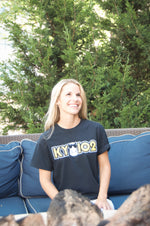 Women wearing KY 102 - classic Kansas City Radio Station Logo with Hippo printed in full color on black crew neck unisex short sleeve t-shirt - Dalton Ink