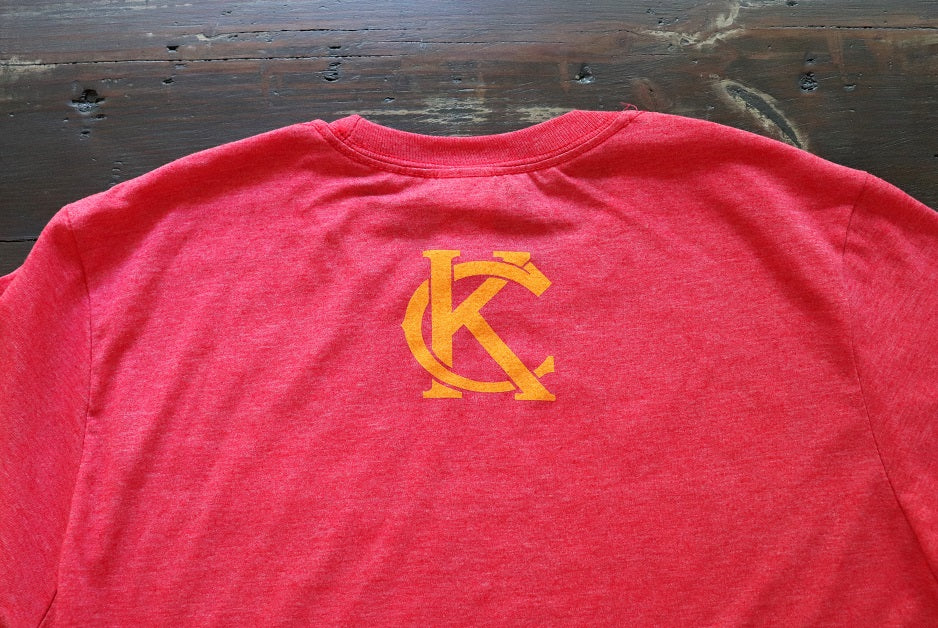Heather Red Unisex short sleeve t-shirt featuring Kansas City vintage KC logo in gold print on the back upper neck - Dalton Ink