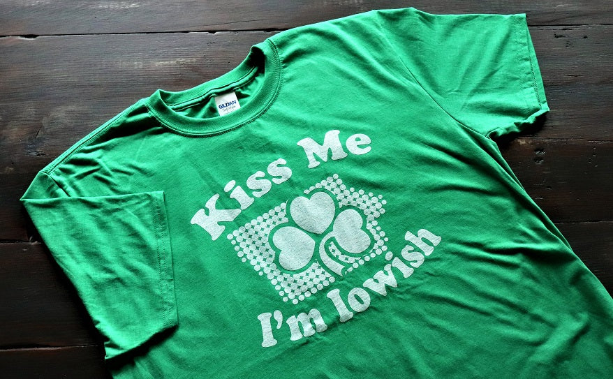 Kiss me I'm Iowish - Softstyle green short sleeve unisex t-shirt with Kiss Me I'm Iowish in white text with a white Iowa and shamrock - for St. Patrick's Day from Dalton Ink featured on KCSHIRTS.com