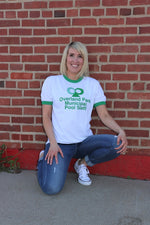 Woman wearing Historic Kansas City Overland Park Municipal Pool Staff Vintage logo printed in green on a white unisex short sleeve green ringer t-shirt - Dalton Ink