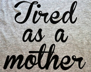"Fun novelty t-shirt with ""Tired as a Mother"" printed in black on a heather grey soft style t-shirt unisex close up - Dalton Ink"
