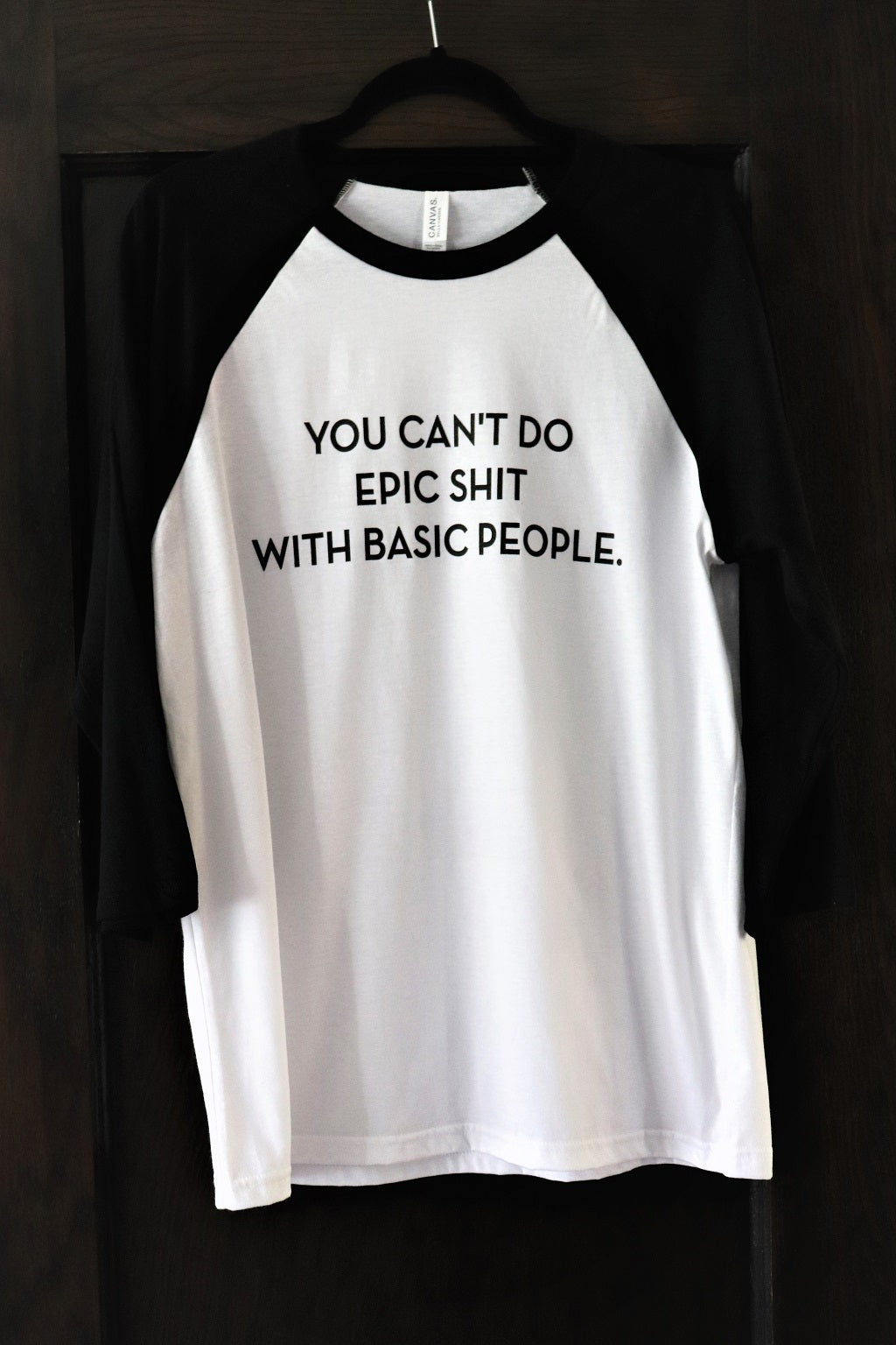 """You Can't Do Epic Shit with Basic People"" in black text on a unisex baseball crew t-shirt white body and 3/4 black sleeves - Dalton Ink"