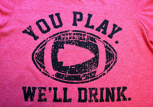 "Close Up Kansas City ""You Play We'll Drink"" Featuring an Arrowhead in the middle of a football short sleeve unisex crew neck t-shirt in heather red - Dalton Ink"