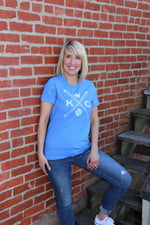 Women wearing Vintage Kansas City soft style heather blue unisex short sleeve t-shirt featuring the vintage KC logo Sporting the vintage KC logo, crossed baseball bats, Crown and baseball in white print across the chest - Dalton Ink