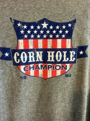 "Close up of Fun Novelty unisex heather grey soft style short sleeve t-shirt with a full color ""Corn Hole Champion""  logo - Dalton Ink"