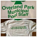 Close up of Historic Kansas City Overland Park Municipal Pool Staff Vintage logo printed in green on a white unisex short sleeve green ringer t-shirt with back saying It is now time for the two o'clock adult swim - Dalton Ink