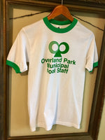 Historic Kansas City Overland Park Municipal Pool Staff Vintage logo printed in green on a white unisex short sleeve green ringer t-shirt - Dalton Ink