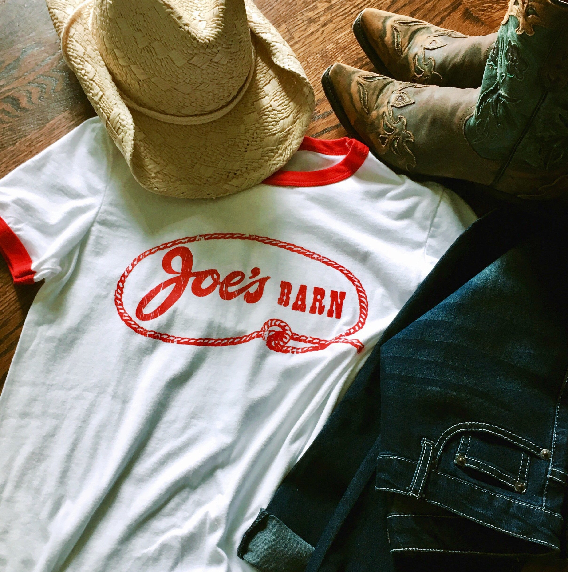 Historic Kansas City Joe's Barn Vintage logo printed in red on a white unisex short sleeve red ringer t-shirt - featured with cowboy hat, boots and jeans - Dalton Ink