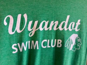 Close up of Vintage Kansas City Wyandot Swim Club logo featured in white ink on a green unisex short sleeve t-shirt - Dalton Ink