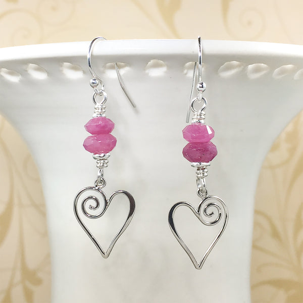 Sterling earrings with faceted ruby beads and spiral heart charms