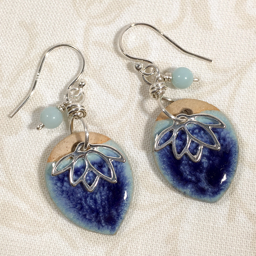Sterling earrings with two-tone blue art ceramic charms, lotus charms, and amazonite beads