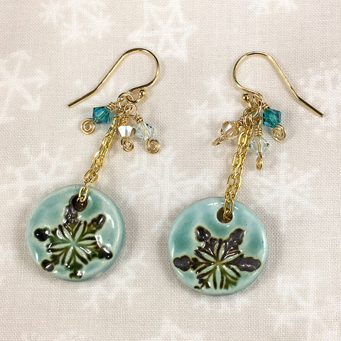 Gold-filled earrings with aqua ceramic snowflake charms and Swarovski crystals