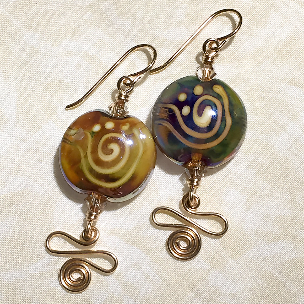 Gold-filled earrings with gold spiral design art glass beads and handmade spiral charms