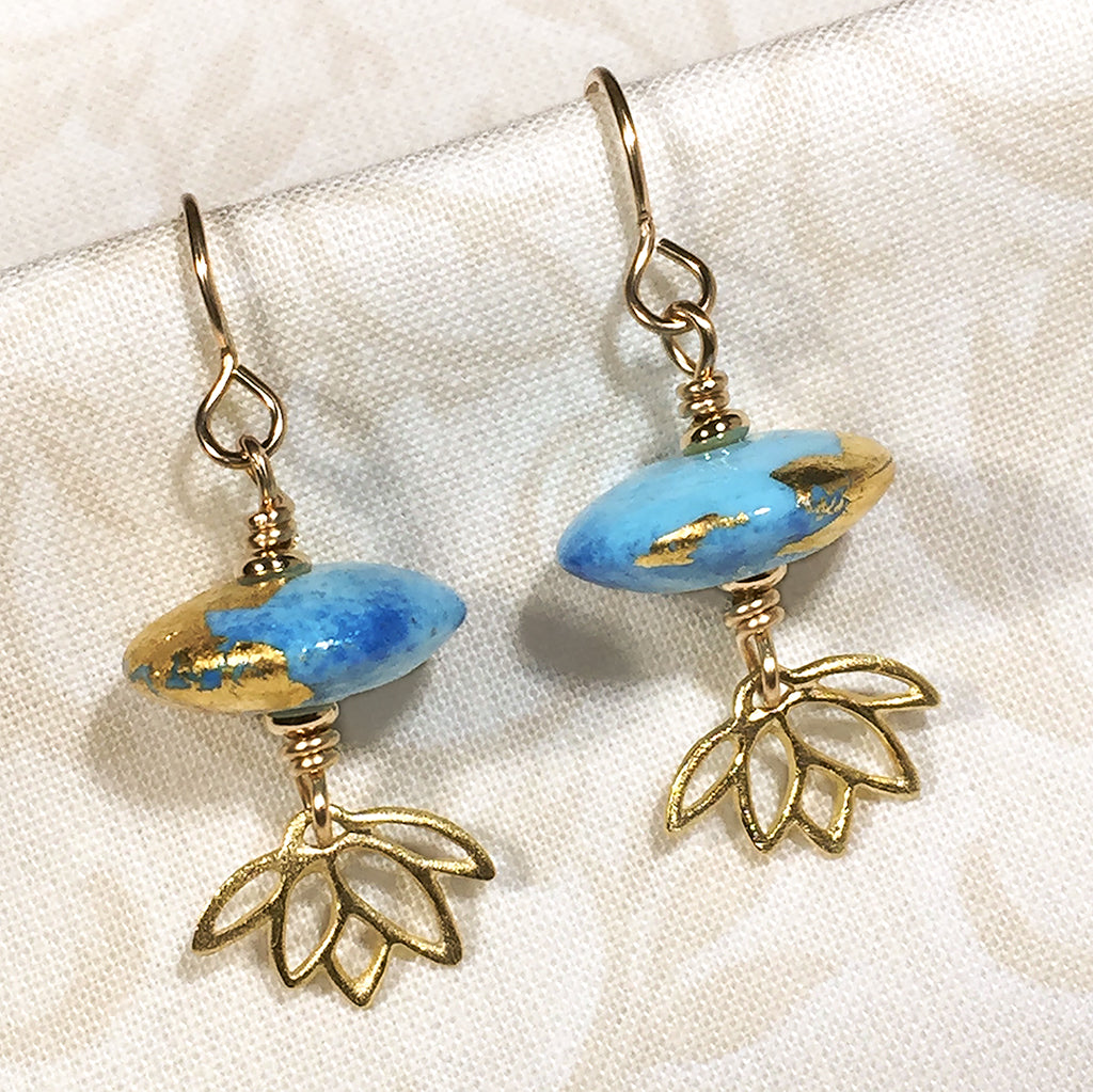 Gold-filled earrings with two-tone blue art glass beads and gold-plated sterling lotus charms