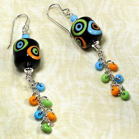 Sterling earrings with black/orange/blue/green mod style art glass beads