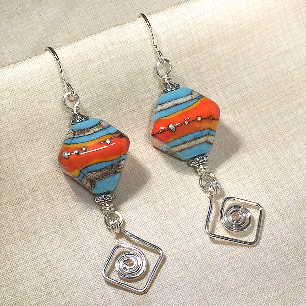 Sterling earrings with blue/orange art glass beads and square spiral charms