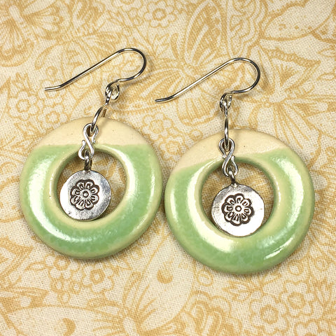 Sterling and fine silver earrings with pistachio green art ceramic rings and Hill Tribe silver flower charms