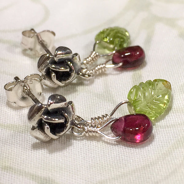 Sterling rose post earrings with pink tourmaline beads and carved peridot leaves