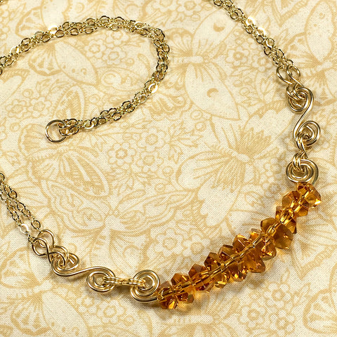 Gold-filled spiral necklace with faceted citrine nugget beads