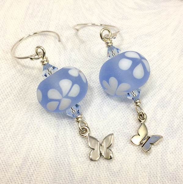 Sterling earrings with sky blue and white floral art glass beads and silver butterfly charms