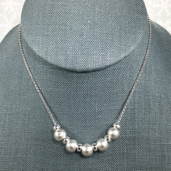 Sterling silver necklace with 12-star pattern beads