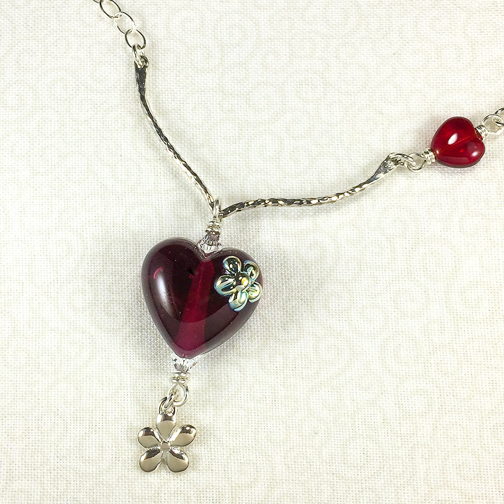Sterling necklace with wine-red art glass heart bead and silver flowers