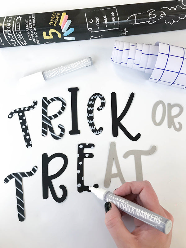 chalk markers on chalkboard halloween decor