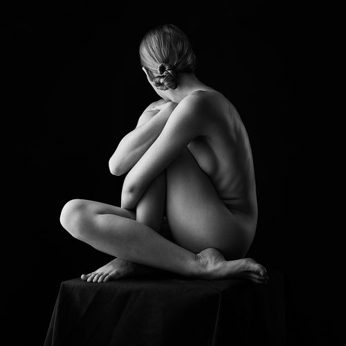 Black and white photograph of nude model woven in a pretzel ball shape. Image by Jeffrey Paul Gunthart.