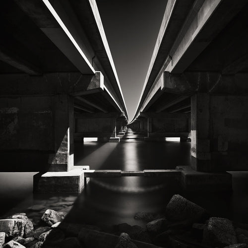 Black and white photograph of the underbelly of a bridge in Sarasota, Florida. Image by Jeffrey Paul Gunthart.