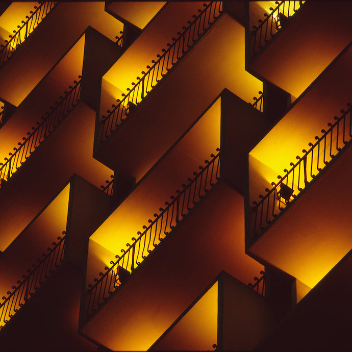 Glowing gold, rectangular balconies. Photo by Wayne Eastep, documentary photographer based out of Sarasota, Florida.