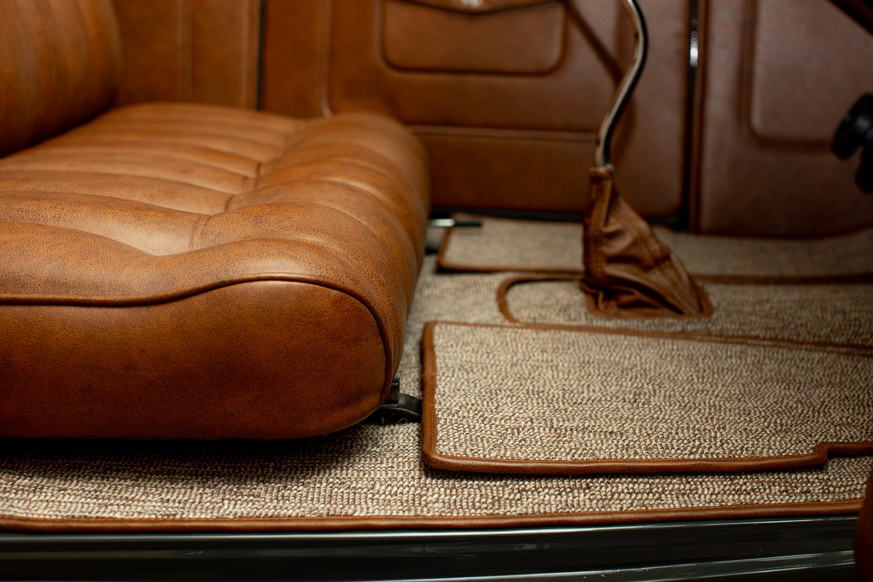 1932 Ford Roadster with Relicate Vintage Saddle Distressed Leather honey brown square weave carpet
