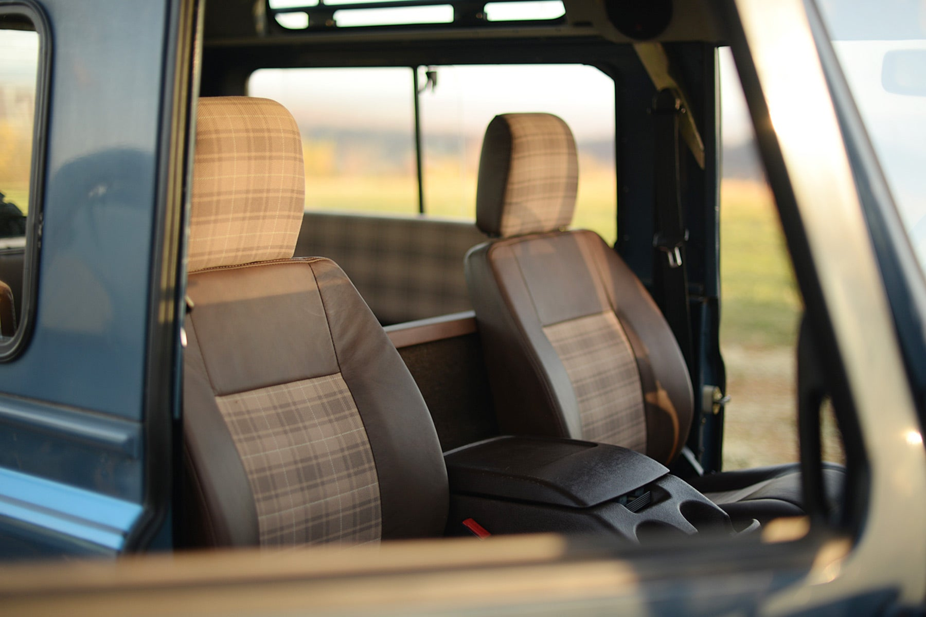 Relicate Leather Land Rover Defender interior with plaid cloth inserts