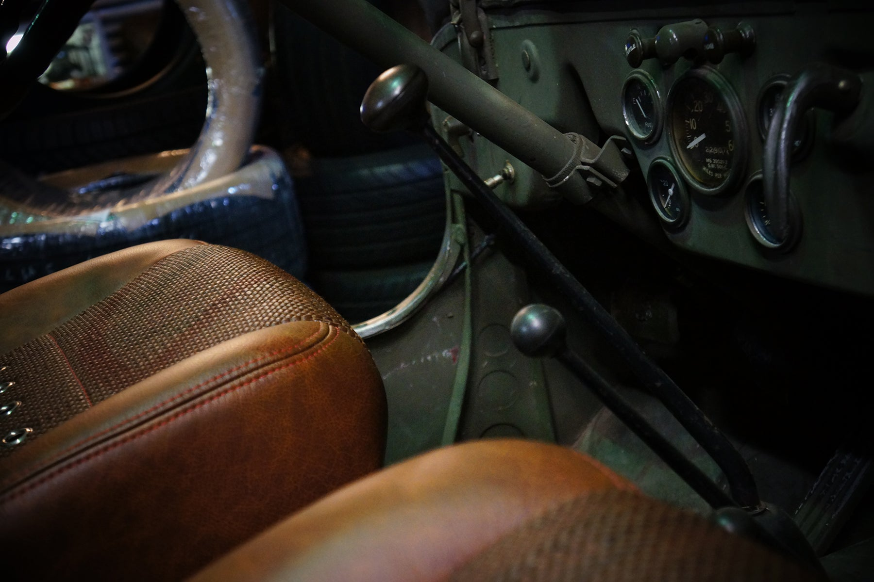 Relicate Rich Clay Distressed Leather Hides in Jeep bucket seats with woven leather